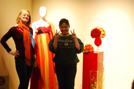 Tanti Lina, right, with her floral arrangement inspired by a dress created by a Moore College of Art & Design fashion student.