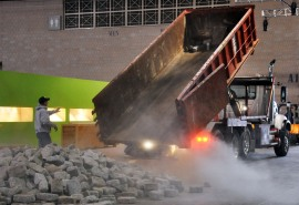 Photo of a dump truck unloading rock in the Convention Center